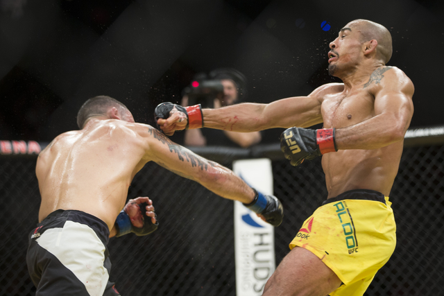 Frankie Edgar, left, connects a punch against Jose Aldo in the interim featherweight title bout during UFC 200 at T-Mobile Arena on Saturday, July 9, 2016, in Las Vegas. Aldo won by unanimous deci ...