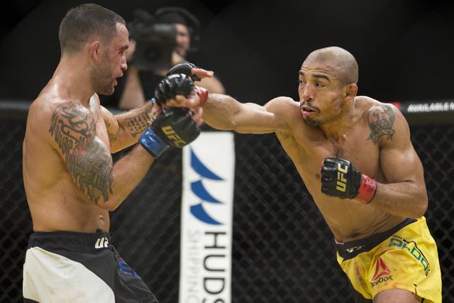 Frankie Edgar, left, battles Jose Aldo in the interim featherweight title bout during UFC 200 at T-Mobile Arena on Saturday, July 9, 2016, in Las Vegas. Aldo won by unanimous decision. (Erik Verdu ...