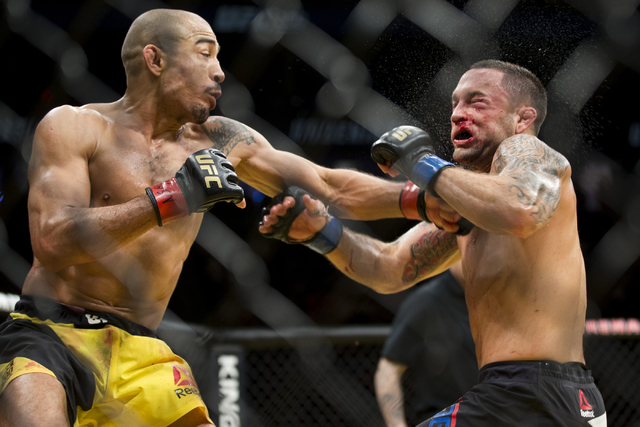 Jose Aldo, left, connects a left punch against Frankie Edgar in the interim featherweight title bout during UFC 200 at T-Mobile Arena on Saturday, July 9, 2016, in Las Vegas. Aldo won by unanimous ...
