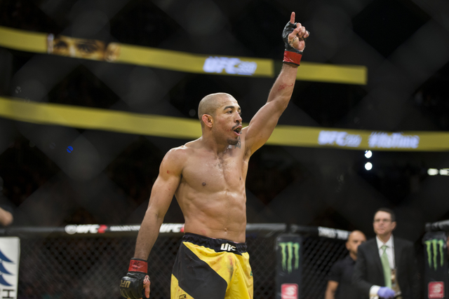 Jose Aldo raises his arm in victory against Frankie Edgar in the interim featherweight title bout during UFC 200 at T-Mobile Arena on Saturday, July 9, 2016, in Las Vegas. Aldo won by unanimous de ...
