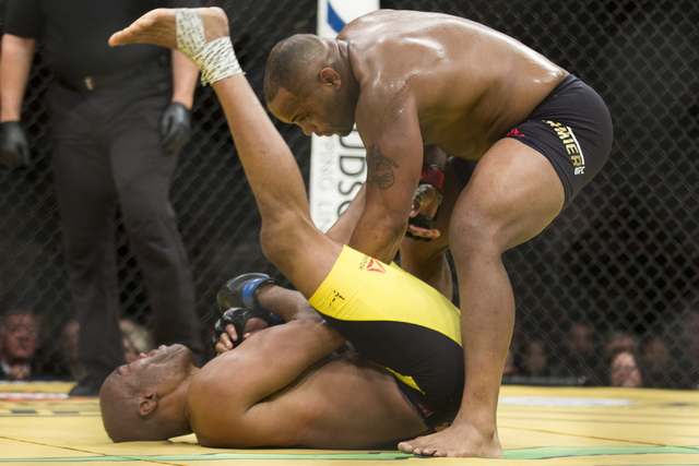 Anderson Silva, left, is taken down against Daniel Cormier in the light heavyweight bout during UFC 200 at T-Mobile Arena on Saturday, July 9, 2016, in Las Vegas. Cormier won my unanimous decision ...