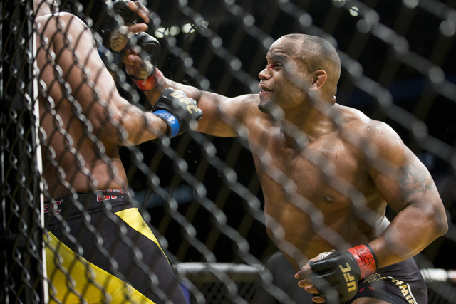 Daniel Cormier, right, throws a punch against Anderson Silva in the light heavyweight bout during UFC 200 at T-Mobile Arena on Saturday, July 9, 2016, in Las Vegas. Cormier won my unanimous decisi ...