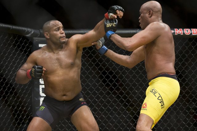 Daniel Cormier, left, throws a punch against Anderson Silva in the light heavyweight bout during UFC 200 at T-Mobile Arena on Saturday, July 9, 2016, in Las Vegas. Cormier won my unanimous decisio ...