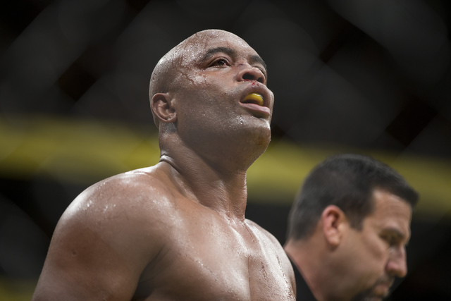 Anderson Silva walks to his corner between round in his fight against Daniel Cormier in the light heavyweight bout during UFC 200 at T-Mobile Arena on Saturday, July 9, 2016, in Las Vegas. Cormier ...