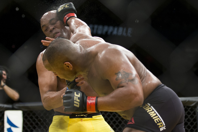 Daniel Cormier, right, connects a right punch against Anderson Silva in the light heavyweight bout during UFC 200 at T-Mobile Arena on Saturday, July 9, 2016, in Las Vegas. Cormier won my unanimou ...