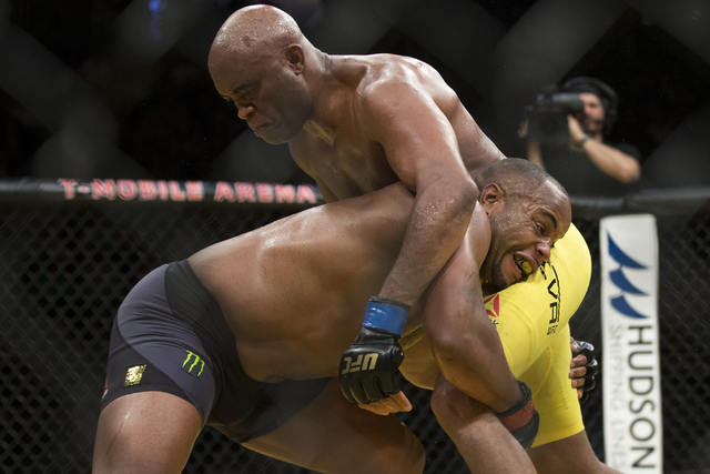Daniel Cormier, left, battles Anderson Silva in the light heavyweight bout during UFC 200 at T-Mobile Arena on Saturday, July 9, 2016, in Las Vegas. Cormier won my unanimous decision. (Erik Verduz ...