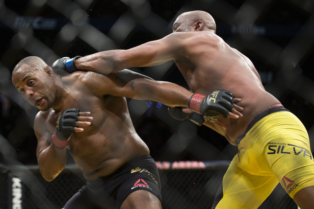 Anderson Silva, right, throws a punch against Daniel Cormier in the light heavyweight bout during UFC 200 at T-Mobile Arena on Saturday, July 9, 2016, in Las Vegas. Cormier won my unanimous decisi ...