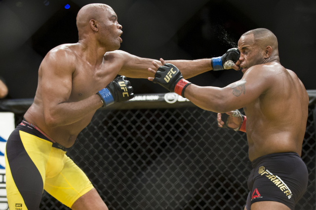 Anderson Silva, left, connects a left punch against Daniel Cormier in the light heavyweight bout during UFC 200 at T-Mobile Arena on Saturday, July 9, 2016, in Las Vegas. Cormier won my unanimous  ...