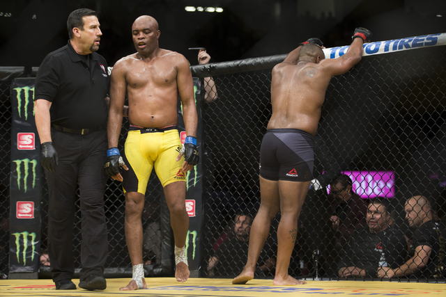 Anderson Silva, left, and Daniel Cormier complete their light heavyweight bout during UFC 200 at T-Mobile Arena on Saturday, July 9, 2016, in Las Vegas. Cormier won my unanimous decision. (Erik Ve ...