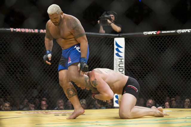Mark Hunt, left, moves away from a tackle by Brock Lesnar in the heavyweight bout during UFC 200 at T-Mobile Arena on Saturday, July 9, 2016, in Las Vegas. Lesnar won by unanimous decision. (Erik  ...