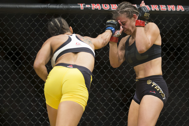 Amanda Nunes, left, connects a right punch against Miesha Tate in the women's bantamweight title bout during UFC 200 at T-Mobile Arena on Saturday, July 9, 2016, in Las Vegas. Nunes won by submiss ...