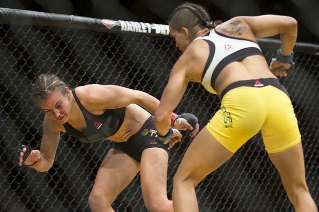 Miesha Tate, left, battles Amanda Nunes in the women's bantamweight title bout during UFC 200 at T-Mobile Arena on Saturday, July 9, 2016, in Las Vegas. Nunes won by submission in the first round. ...