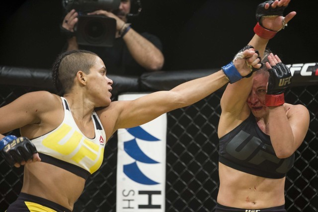 Amanda Nunes, left, throws a punch against Miesha Tate in the women's bantamweight title bout during UFC 200 at T-Mobile Arena on Saturday, July 9, 2016, in Las Vegas. Nunes won by submission in t ...