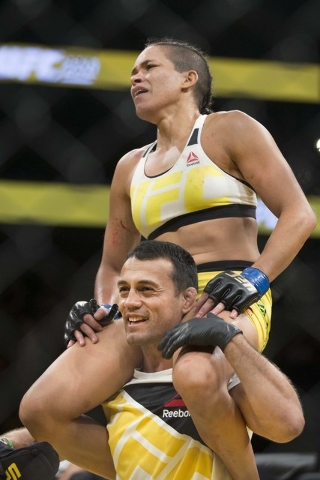Amanda Nunes celebrates her win against Miesha Tate by submission in the women's bantamweight title bout during UFC 200 at T-Mobile Arena on Saturday, July 9, 2016, in Las Vegas. (Erik Verduzco/La ...