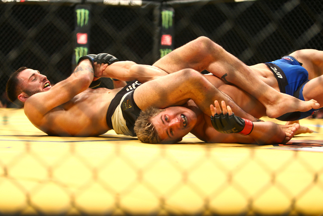 Enrique Marin grapples with Sage Northcutt during their lightweight fight at UFC 200 at T-Mobile Arena in Las Vegas on Saturday, July 9, 2016. Loren Townsley/Las Vegas Review-Journal Follow @loren ...