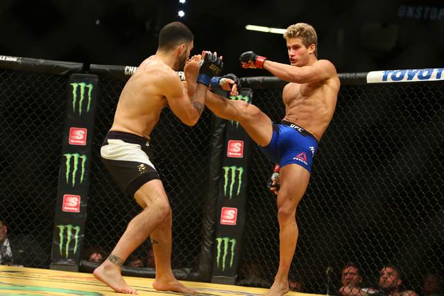 Sage Northcutt connects with a kick against Enrique Marin during their lightweight fight at UFC 200 at T-Mobile Arena in Las Vegas on Saturday, July 9, 2016. Loren Townsley/Las Vegas Review-Journa ...
