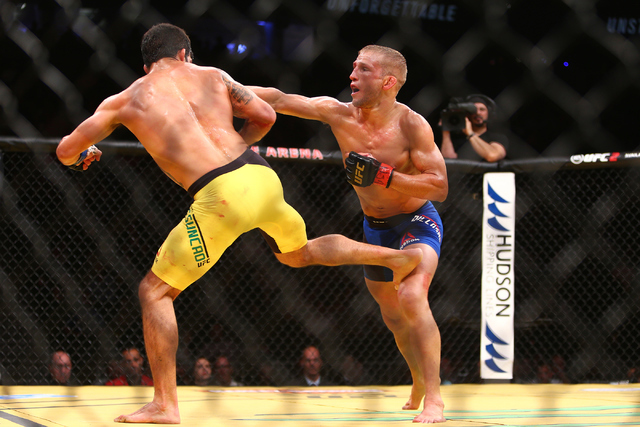 TJ Dillashaw lands a strike against Raphael Assuncao during their bantamweight fight at UFC 200 at T-Mobile Arena in Las Vegas on Saturday, July 9, 2016. Loren Townsley/Las Vegas Review-Journal Fo ...