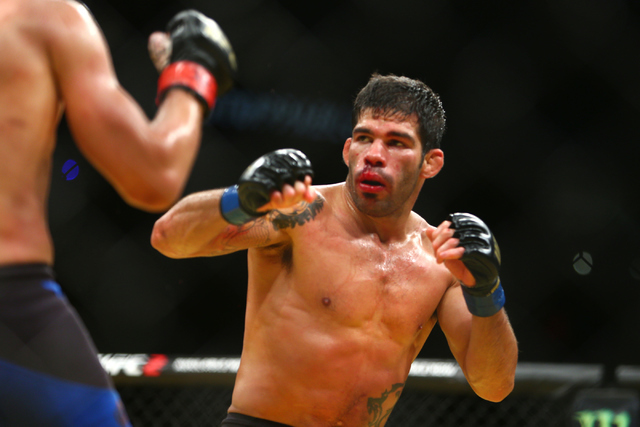 Raphael Assuncao competes against TJ Dillashaw during their bantamweight fight at UFC 200 at T-Mobile Arena in Las Vegas on Saturday, July 9, 2016. Loren Townsley/Las Vegas Review-Journal Follow @ ...