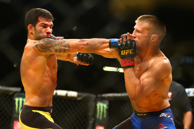 TJ Dillashaw, left and Raphael Assuncao land a strike during their bantamweight fight at UFC 200 at T-Mobile Arena in Las Vegas on Saturday, July 9, 2016. Loren Townsley/Las Vegas Review-Journal F ...