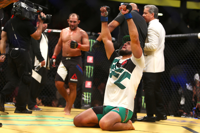 Kelvin Gastelum celebrates after defeating Johnny Hendricks during their welterweight fight UFC 200 at T-Mobile Arena in Las Vegas on Saturday, July 9, 2016. Loren Townsley/Las Vegas Review-Journa ...