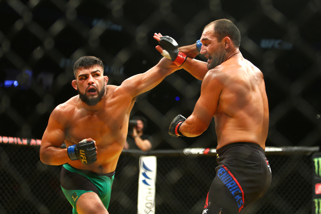 Kelvin Gastelum lands a strike against Johnny Hendricksduring their welterweight fight at UFC 200 at T-Mobile Arena in Las Vegas on Saturday, July 9, 2016. Loren Townsley/Las Vegas Review-Journal  ...