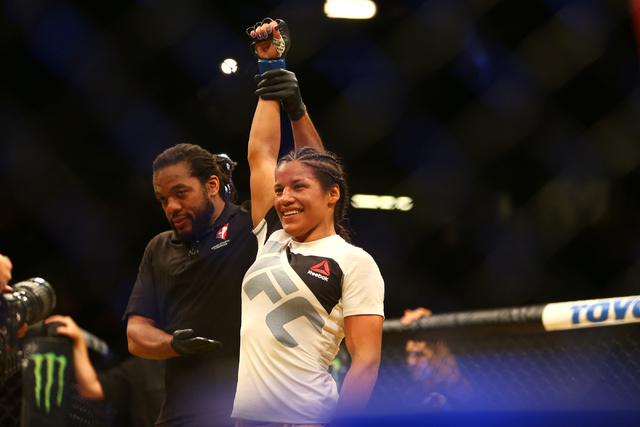 Julianna Pena celebrates after defeating Cat Zingano during the women's bantamweight fight UFC 200 at T-Mobile Arena in Las Vegas on Saturday, July 9, 2016. Loren Townsley/Las Vegas Review-Journal ...