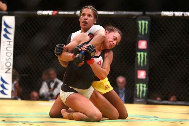 Julianna Pena grapples with Cat Zingano during the women's bantamweight fight UFC 200 at T-Mobile Arena in Las Vegas on Saturday, July 9, 2016. Loren Townsley/Las Vegas Review-Journal Follow @lore ...