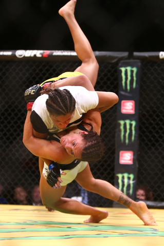 Cat Zingano secures a takedown against Julianna Pena during the women's bantamweight fight UFC 200 at T-Mobile Arena in Las Vegas on Saturday, July 9, 2016. Loren Townsley/Las Vegas Review-Journal ...