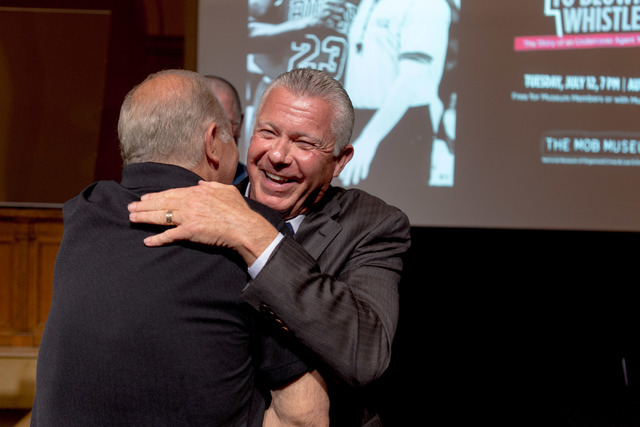 Bob Delaney, a former undercover agent for New Jersey State Police turned NBA official, greets fellow NBA referees after an author talk at the Mob Museum, Las Vegas, Tuesday, July 12, 2016. Elizab ...