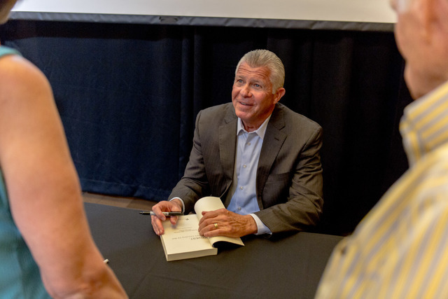 "Bob Delaney, a former undercover agent for New Jersey State Police turned NBA official, signs a copy of his book, ""Covert: My Years Infiltrating the Mob"" after an author talk at  ..."