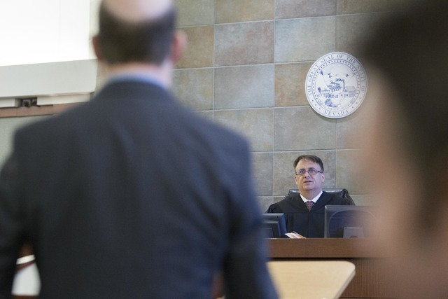 District Judge Richard Scotti, center, presides over the case of Bayzle Morgan at the Regional Justice Center in downtown Las Vegas on Thursday, July 21, 2016. Richard Brian/Las Vegas Review-Journ ...