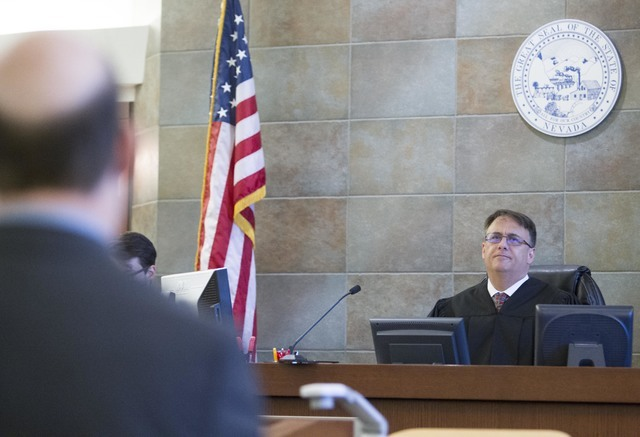 District Judge Richard Scotti, right, presides over the case of Bayzle Morgan at the Regional Justice Center in downtown Las Vegas on Thursday, July 21, 2016. Richard Brian/Las Vegas Review-Journa ...