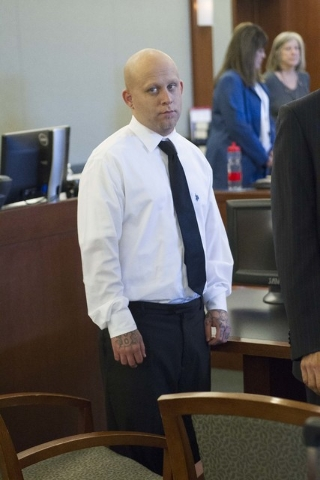 Bayzle Morgan looks at people entering the courtroom during jury selection in his trial at the Regional Justice Center in downtown Las Vegas on Monday, July 25, 2016. Richard Brian/Las Vegas Revie ...