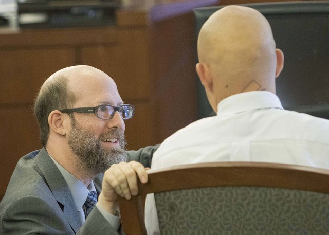 Bayzle Morgan, right, speaks with attorney David Figler while on a break during jury selection in his trial at the Regional Justice Center in downtown Las Vegas on Monday, July 25, 2016. Richard B ...