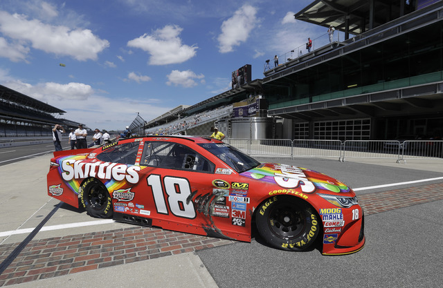 Sprint Cup Series driver Kyle Busch pulls onto pit road during practice for the Brickyard 400 NASCAR auto race at Indianapolis Motor Speedway in Indianapolis, Friday, July 22, 2016. (Darron Cummin ...