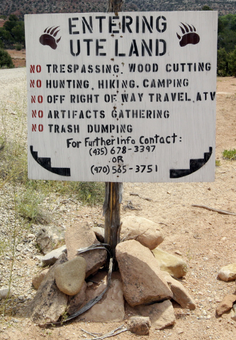 "A entering ""UTE Land"" sign is shown, near Blanding, Utah, on June 22. (Rick Bowmer/The Associated Press)"