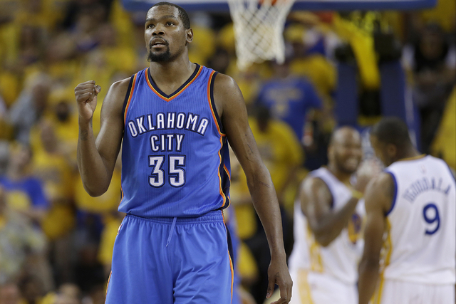 Oklahoma City Thunder forward Kevin Durant (35) reacts during the second half of Game 7 of the NBA basketball Western Conference finals against the Golden State Warriors in Oakland, Calif., in thi ...
