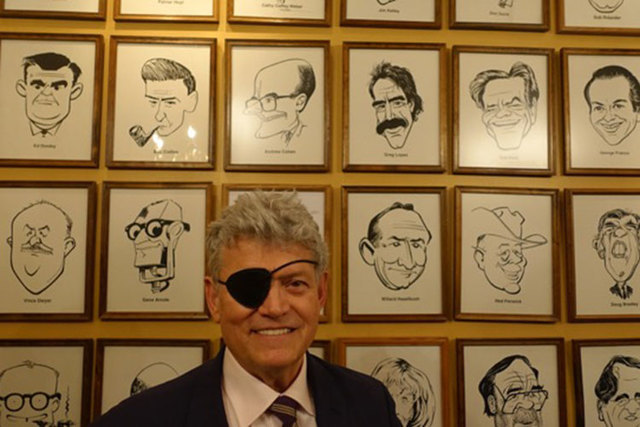 Review-Journal columnist Norm Clarke in the Denver Press Club's caricature room after receiving the Damon Runyon Award on Friday, April 24, 2015. (Courtesy)