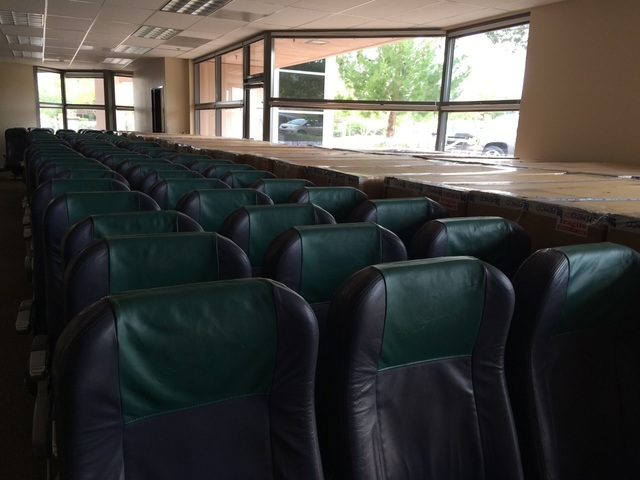 Rows of airlines seats sit May 17 at the space Make-a-Wish will lease from Allegiant Airlines for its new offices. The 7,500-square-foot space will cost the nonprofit $1 a year. Crews will soon co ...