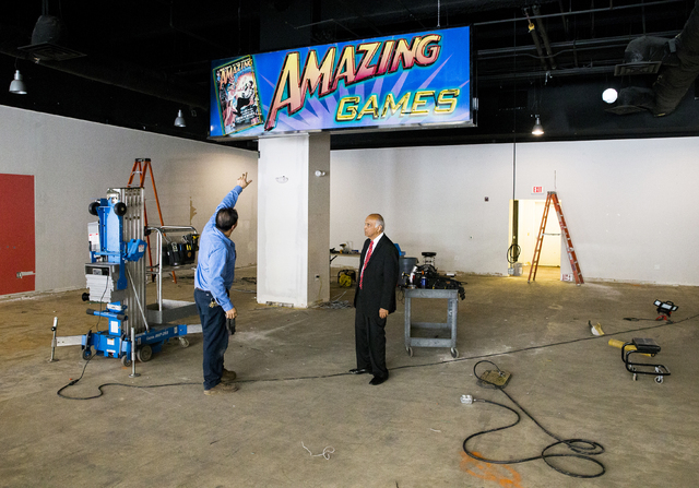 Neonopolis owner Rohit Joshi, right, speaks to building engineer Ricky Quiroga about the installation of a new arcade business on Tuesday, July 12, 2016, in Las Vegas. Benjamin Hager/Las Vegas Rev ...