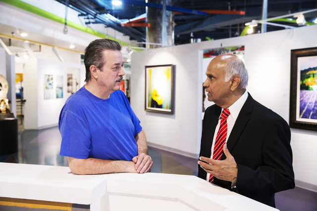 Neonopolis owner Rohit Joshi, right, discusses an upcoming exhibit with Mark Rowland, executive director of the Southern Nevada Museum of Fine Art, on Tuesday, July 12, 2016, in Las Vegas. Benjami ...