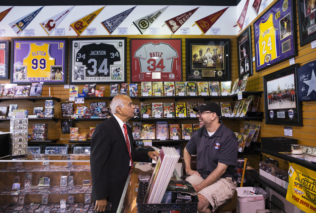 Neonopolis owner Rohit Joshi, left, talks business with Rob Vandorick, store manager at Ultimate Sports Cards and Memorabilia, on Tuesday, July 12, 2016, in Las Vegas. Benjamin Hager/Las Vegas Rev ...