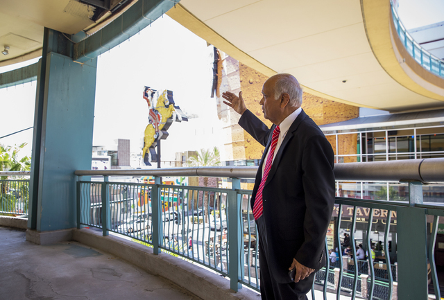 Neonopolis owner Rohit Joshi gestures towards the view diners will have from the new Italian eatery Fat Papa's on Tuesday, July 12, 2016, in Las Vegas. Benjamin Hager/Las Vegas Review-Journal