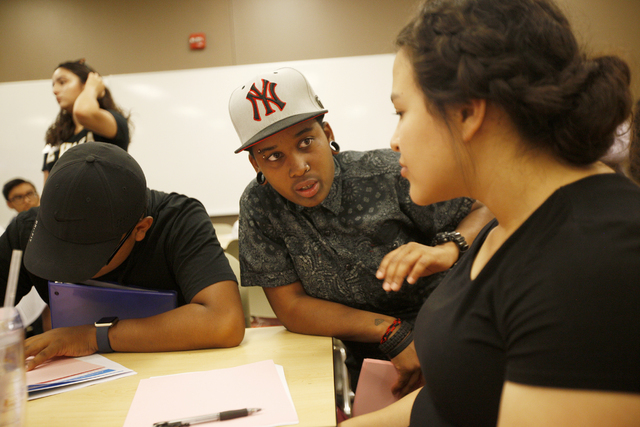 Student mentor Moe Turban, center, speaks to Marian Melchor during a narrative-approach workshop as part of the Nepantla program on Wednesday, June 29, 2016, at Nevada State College in Henderson.  ...