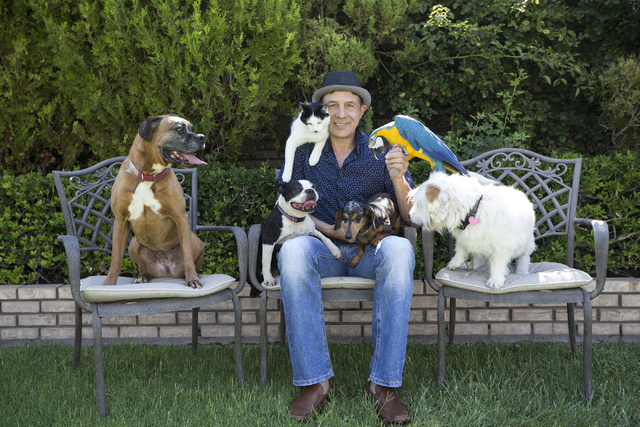 Gregory Popovich poses for a photo with his pets at his North Las Vegas home June 24. Erik Verduzco/View