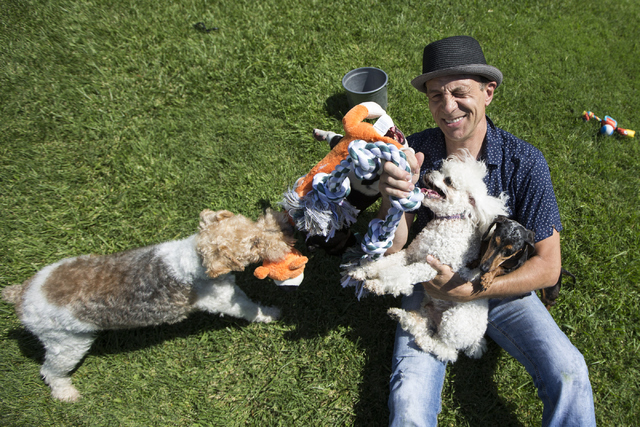 Gregory Popovich plays with his dogs at his North Las Vegas home June 24. Erik Verduzco/View