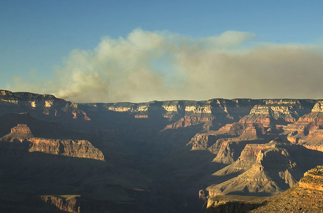 A wildfire burns on the north rim of the Grand Canyon as seen from the Bright Angel Trail below the south rim of the canyon in Grand Canyon National Park in Arizona, Thursday, July 14, 2016. (Davi ...