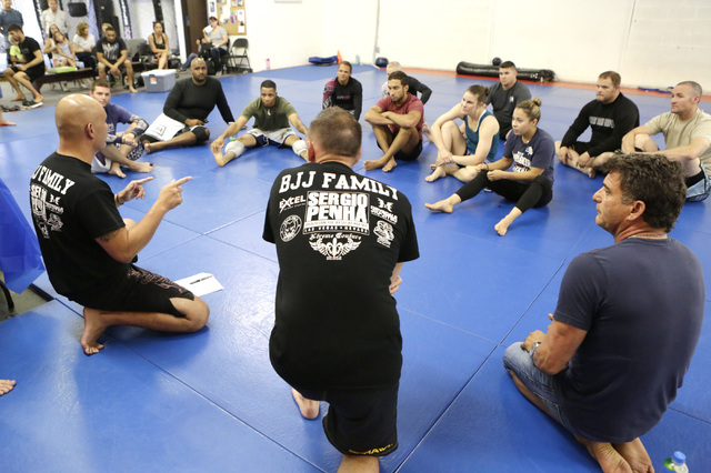 Lt. Will Huddler, of Las Vegas Metro police, left, speaks to participants prior to the start of the 2016th officer David VanBuskirk-Memorial Grappling Event at Sergio Penha's Brazilian Jiu-Jitsu A ...