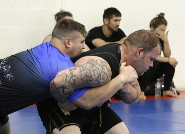 Henderson police officer, Matt Brown, right, and Lu Messer, Carlsbad, N.M., firefighter compete during the 2016th Officer David VanBuskirk-Memorial Grappling Event at Sergio Penha's Brazilian Jiu- ...