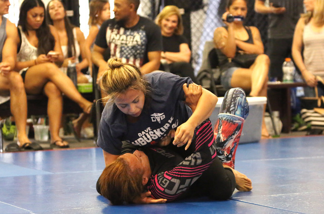 Fanny Tommasino, top, and Memphis police officer, Jennifer Robinson compete during the 2016th Officer David VanBuskirk-Memorial Grappling Event at Sergio Penha's Brazilian Jiu-Jitsu Academy on Sat ...